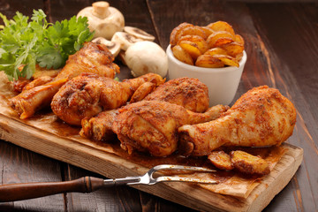 Roasted chicken legs with potato chips