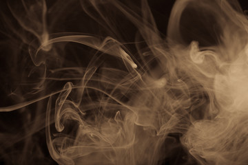 Cloud of smoke on black background. Selective focus. Toned