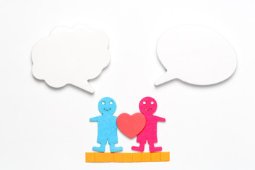 Two human figures in love with empty speech bubbles
