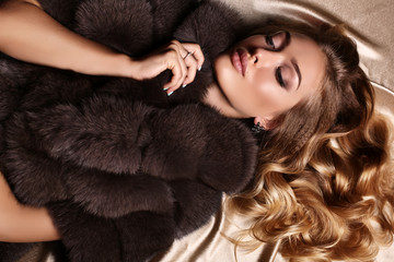 gorgeous sensual woman with blond hair in luxurious fur coat Wall mural