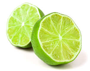 two Lime halves isolated on white background