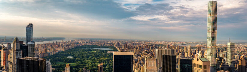 "Panorama cityscape view on Central Park, New York, seen from the Rockefeller building ""Top of the Rocks"" before summer sunset."