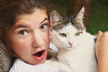 teen girl hug cat close up portrait