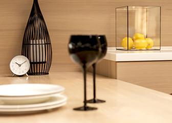 wine glasses in black, watch, lemons