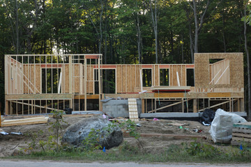 raised bungalow construction site in a cottage country with wild forest on a background