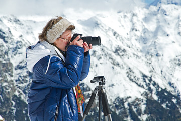 Girl photographer mountains