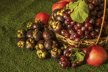 Still life for with autumn fruits grape apple and mangosteen
