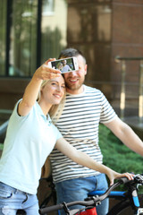 Happy couple taking selfie on the street