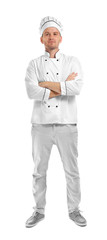 Young chef cook with crossed arms isolated on white