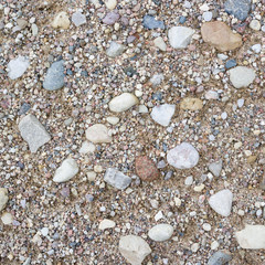Rural road close-up. Stone and sand texture or background.