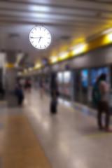 Blurred background of passenger at subway terminal.