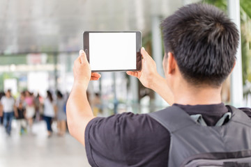 the tourist Man taking pictures with a tablet.