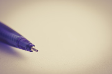 A pen on white paper.