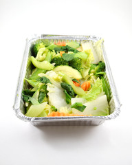 Vegetables in metal takeout tray