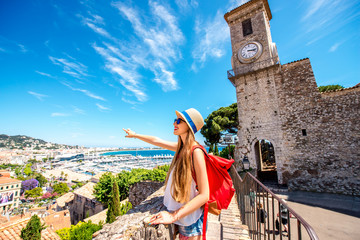 Young female traveler enjoying great view on Cannes city from the castle hill in France