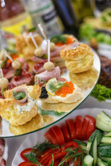 decorated catering banquet table with different food snacks