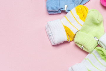 Cotton baby socks for newborn on a colorful pink background. Copy space
