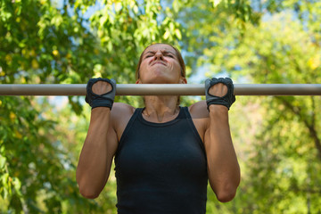 Chin ups on chin up bar in the park