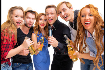 Party, holiday, relax and celebration. Group of  happy smiling friends having fun together, singing karaoke. Isolated on white.