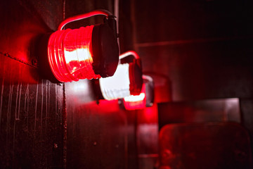 Red Alert light in protective cage aboard