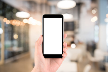 hand holding the phone tablet on blurred in shop or restaurant background;Transactions by smartphone concept