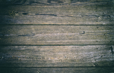 Outdoor old blue green wooden planks floor background with viggnette effect.