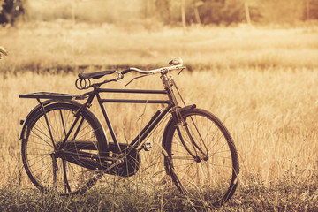 beautiful landscape image with vintage Bicycle at sunset,classic