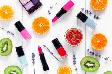 cosmetic on white table with colorfull fruits top view