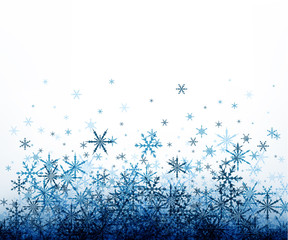 Winter background with blue snowflakes.