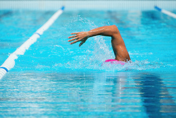 Man swimming the front crawl in a pool