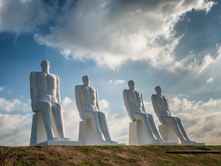 Men at sea colossal sculptures near Esbjerg harbor in Denmark Fototapete