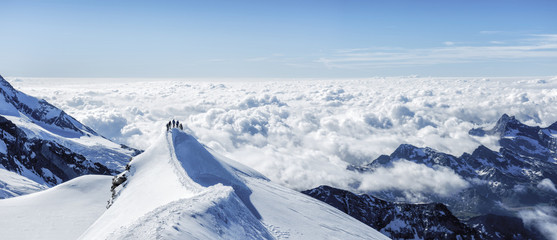 Mountaineers on top of snowy mountain