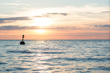 buoy floating in the sunset