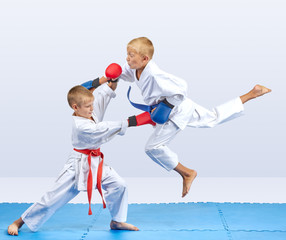 Karate athletes train punch in jump and block