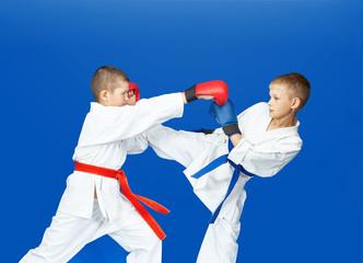 In karategi athletes are hitting punches and kicks