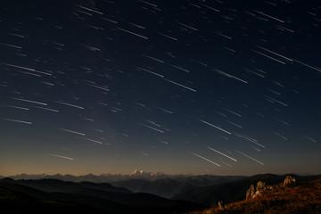 mountains star tracks sky