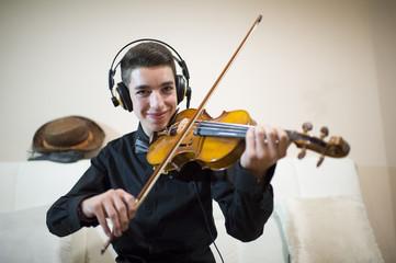 Teen playing a violin