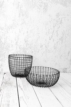 Wire basket on white floor