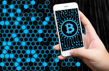 Distributed ledger technology , Man holding mobile phone, block chain text and blockchain icons with binary coded background , cryptocurrencies or bitcoin concept