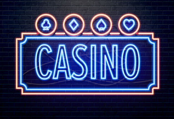 neon casino sign isolated on black brick wall