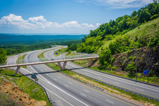 View of I-68 and a pedestrian bridge at Sideling Hill, Maryland.