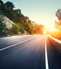 Asphalt road with instagram toning. Landscape with mountain road with a perfect asphalt  at sunset in summer. Vintage, retro style. Travel background. Highway at mountains