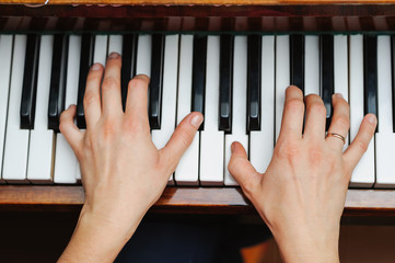 woman hands on a piano key
