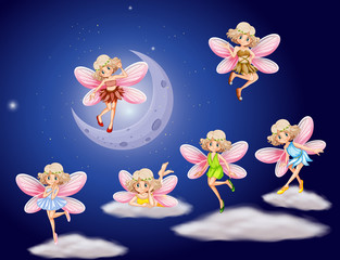 Fairies flying in the sky at night
