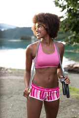 portrait of afro american woman with jump rope