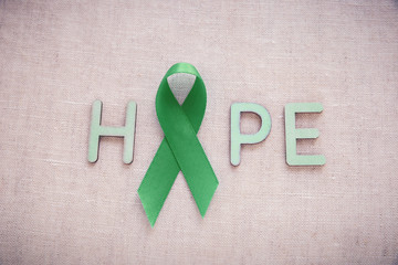 Green Ribbon with HOPE word, cancer awareness, Liver, kidney cancer awareness