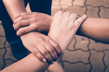 Three hands were a collaboration concept of teamwork
