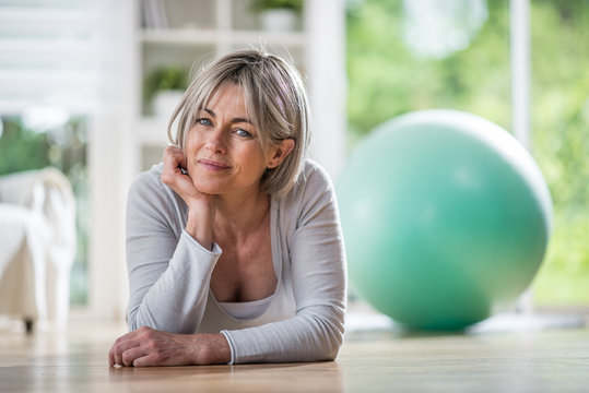 the portrait of a beautiful 50 years who practises Pilates