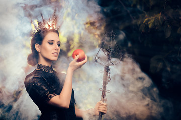 Evil Queen with Poisoned  Apple in Misty Forest Fotomurales