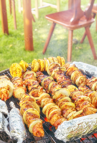meat skewers with onions and corn cobs in aluminum foil. Black Bedroom Furniture Sets. Home Design Ideas